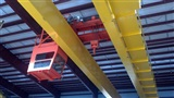 Flying Crane cab of 50 Ton double girder, top running crane where Cab moves with trolley