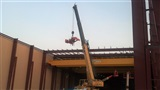 Installation of 33 Ton, 90' span, double girder, top running, remote controlled bridge crane